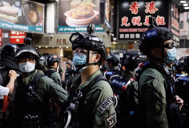 01 October 2020, China, Hong Kong: Riot police stand guard on streets during a p