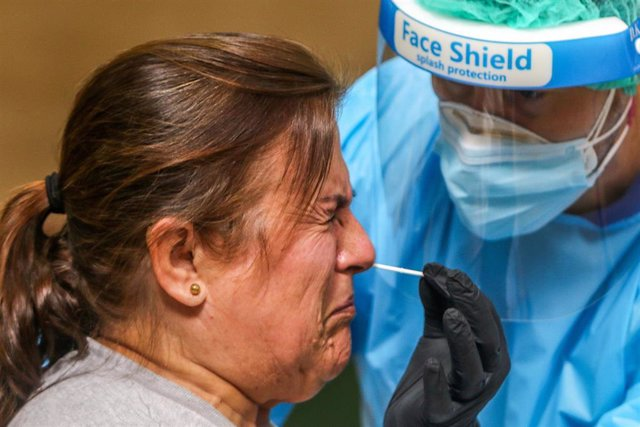 23 October 2020, Spain, Malaga: A health worker performs an antigen coronavirus speed test on a resident from the twon of Axarchic. Photo: Lorenzo Carnero/ZUMA Wire/dpa