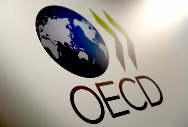 FILED - 27 May 2015, Berlin: The logo of the Organization for Economic Co-operation and Development (OECD) is pictured in Berlin. The OECD on Monday launched a website with interactive environmental data for its 36 member states. Photo: Britta Pedersen/dp