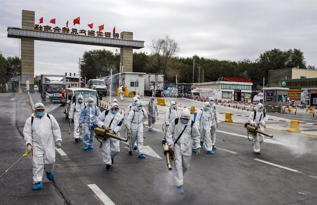 26 August 2020, China, Urumchi: Workers wear protective suits take part in a disinfection process for a street amid the spread of the coronavirus (COVID-19) pandemic. Photo: -/TPG via ZUMA Press/dpa