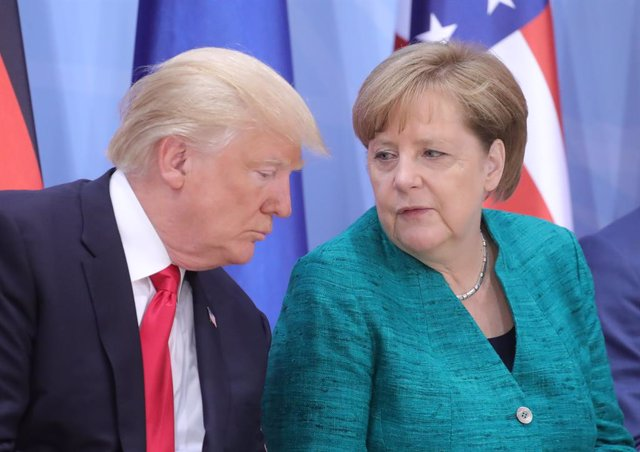 FILED - 08 July 2017, Hamburg: US President Donald Trump (L), speaks with German Chancellor Angela Merkel during a panel discussion at the G20 summit. German Chancellor Angela Merkel has declined an invitation fromUS President Donald Trump to the upcomin