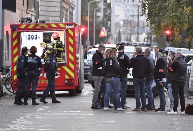 31 October 2020, France, Lyon: Rescue workers and police officers are on the scene where a Greek Orthodox priest was shot. The Greek priest was about to close the church when an attacker armed with a sawn-off shotgun  shot him and fled. The incident occur