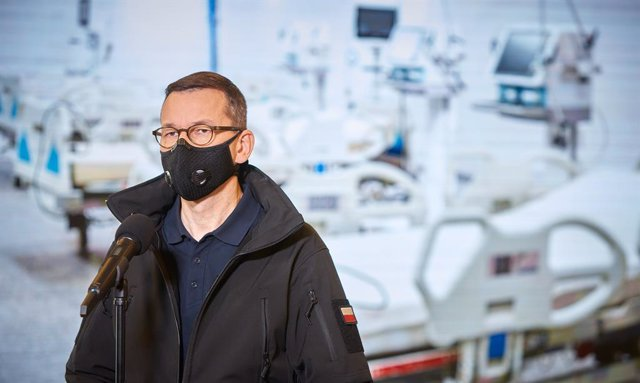 29 October 2020, Poland, Warsaw: Polish Prime Minister Mateusz Morawiecki attends a press conference with Health Minister Adam Niedzielski (Not pictured)at the National Stadium in Warsaw , which is being converted into a temporary hospital for with Coron