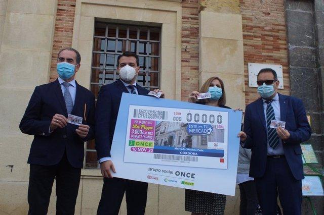 Presentación de la imagen del cupón de la ONCE dedicado al mercado de abastos.