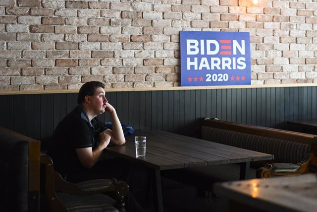 A patron watches the US election day live results during a US election watch party at PJ O'Reilly's Bar in Canberra, Wednesday, November 4, 2020. (AAP Image/Lukas Coch) NO ARCHIVING