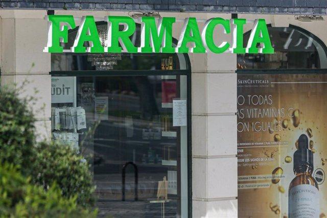 Cartel de una farmacia de la capital