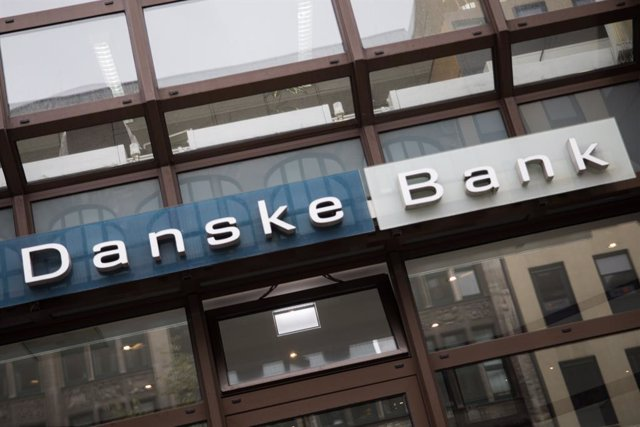 FILED - 26 October 2018, Hamburg: A Danske Bank logo can be seen on a building with a branch of the Danish bank. Danske Bank, Denmark's largest lender, reported roughly unchanged net profit for 2019, which was 15.1 billion kroner (2.2 billion dollars), co