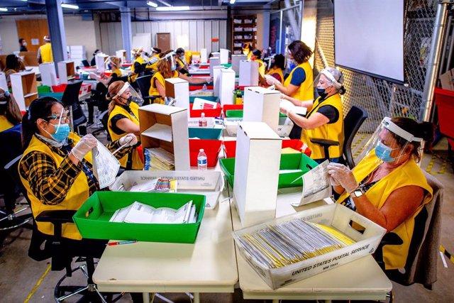 03 November 2020, US, San Bernardino: Election workers process ballots at the San Bernardino County Registrar of Voters office. Photo: Watchara Phomicinda/Orange County Register via ZUMA/dpa