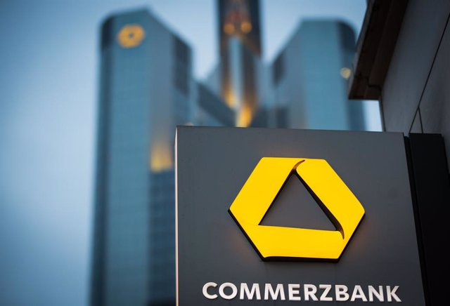 FILED - 10 February 2015, Frankfurt_Main: The logo of a Commerzbank branch is pictured near the head office of Commerzbank.  Germany's Commerzbank said on Friday that 200 of its branches currently closed due to the coronavirus pandemic will not reopen. Ph