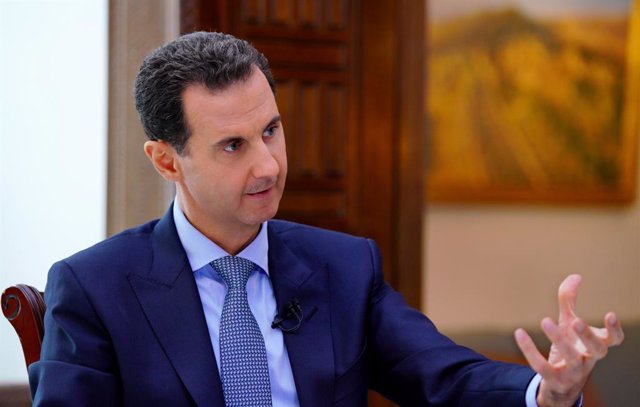 HANDOUT - 15 November 2019, Syria, Damaskus: The photo provided by the Syrian Arab News Agency (SANA) on 11/15/2019 shows Syrian President Bashar al-Assad speaking during a previously recorded television interview  with the RIA Novosti news agency and the
