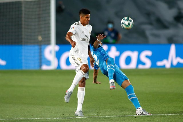 Raphael Varane of Real Madrid and Maximiliano Gomez of Valencia in action during the spanish league, LaLiga, football match played between Real Madrid and Valencia at Alfredo Di Stefano Stadium on June 18, 2020 in Valdebebas, Madrid, Spain. The Spanish La