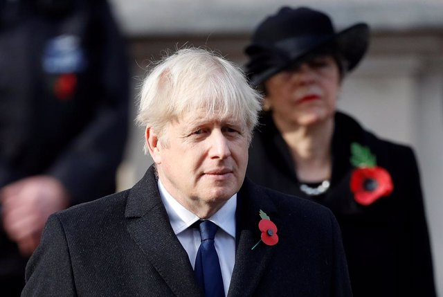 08 November 2020, England, London: British Prime Minister Boris Johnson and former prime minister Theresa May attend the Remembrance Sunday service at the Cenotaph War memorial. Photo: Peter Nicholls/PA Wire/dpa