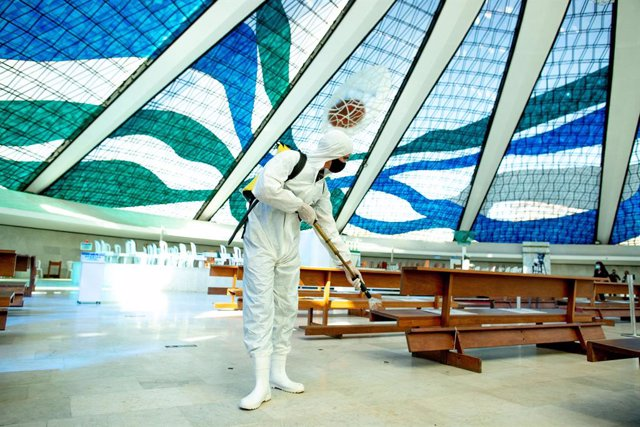 03 September 2020, Brazil, Brasília: A member of the Brazilian army wearing  a full protective suit, disinfects Our Lady of Aparecida cathedral amid the Coronavirus (Covid-19) outbreak. Photo: Myke Sena/dpa