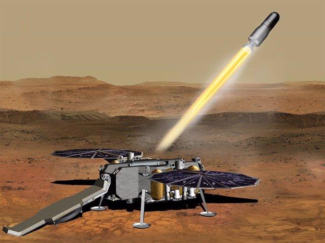 Esta ilustración muestra un concepto de cómo el Vehículo de Ascenso a Marte de la NASA, que transporta tubos que contienen muestras de roca y suelo, podría ser lanzado desde la superficie de Marte en un paso de la misión de retorno de muestras a Marte.