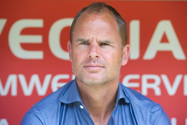 FILED - 06 July 2013, Saxony, Dresden: Then Ajax Amsterdam's coach Frank de Boer is seen on the bench prior to the start of the club friendly soccer match betwwen Dynamo Dresden and Ajax Amsterdam at Gluecksgas-Stadion. Frank de Boer has been named new co