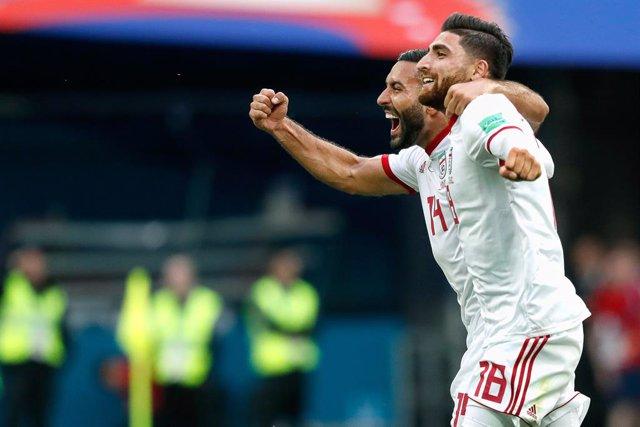 Saint Petersburg, 15-06-2018 , World Cup 2018 , Saint Petersburg Stadium. Iran striker Alireza Jahanbakhsh (R) celebrating the victory after the game with Iran striker Saman Ghoddos (L) after the match Morocco - Iran (0-1) .