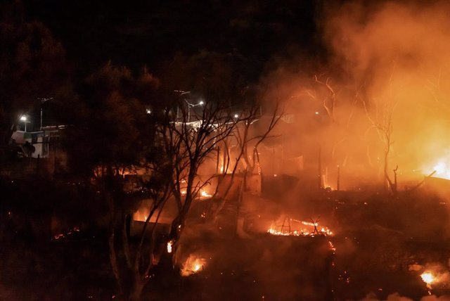 02 November 2020, Greece, amos Island: Smoke billows from a refugee and migrant camp after a fire broke out on the Greek island of Samos. Dozens of accommodations were destroyed by the fire which broke out in the early hours on Monday, three days after an