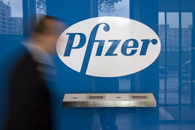 FILED - 06 October 2008, Berlin: A man walks past the logo of the multinational pharmaceutical corporation Pfizer in Berlin. Drug-maker Pfizer says the company may know by the end of October whether its coronavirus vaccine is effective and safe, chief exe