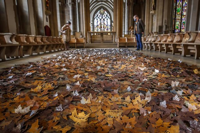 04 October 2020, England, Sheffield: People stop to view 'The Leaves of the Trees' memorial, which is created by the artist Peter Walker to honour those who have passed away during the coronavirus pandemic at Sheffield Cathedral. Photo: Danny Lawson/PA Wi