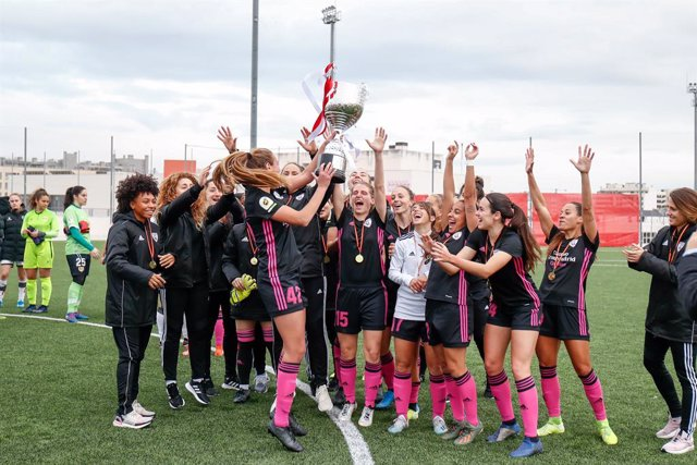 Yasmin Mrabet of Madrid CFF enjoy the Champions trophy with her teammates during the I Trophy Villa de Vallecas women football match played between Rayo Vallecano Femenino and Madrid CFF at Ciudad Deportiva Rayo Vallecano on March 08, 2020 in Madrid, Spai