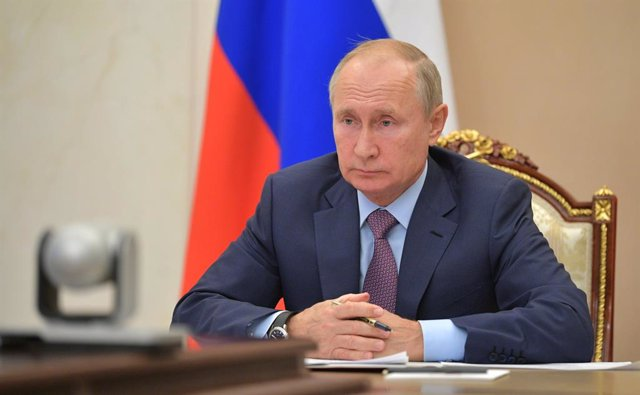 HANDOUT - 14 October 2020, Russia, Novo-Ogaryovo: Russian President Vladimir Putin attends a meeting with members of the government, held via video conference, at the Novo-Ogaryovo state residence. Photo: -/Kremlin/dpa - ATTENTION: editorial use only and