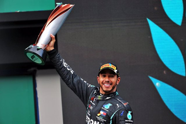 15 November 2020, Turkey, Istanbul: British Formula One driver of Mercedes AMG Petronas team, Lewis Hamilton, celebrates on the podium after winning the Turkish Grand Prix and securing his seventh world championship at Istanbul Park circuit. Photo: -/PA W