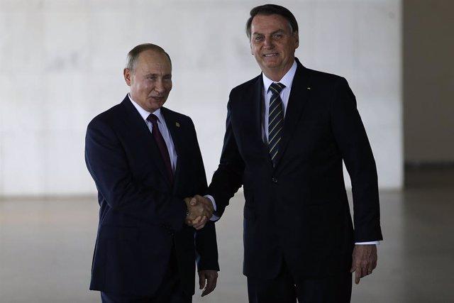 El presidente de Rusia, Vladimir Putin, y el de Brasil, Jair Bolsonaro, durante la cumbre de los BRICS celebrada en 2019 en Brasilia.