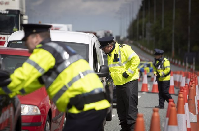 Garda Covid-19 Checkpoint - N7 Motorway, Dublin    Dublin, Ireland - April 29, 2020: a checkpoint on the N7 motorway. Gardaí have set up checkpoints across the country in a bid to limit people breaking the Government's Covid-19 travel restrictions.
