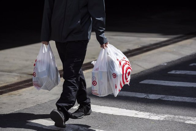 March 30, 2019 - New York, New York, United States: A man carries Target plastic shopping bags on east 117th Street in Manhattan. (Natan Dvir / Contacto Images)