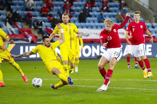 11 October 2020, Norway, Oslo: Norway's Erling Braut Haaland scores his side's fourth goal during the UEFA Nations League Group 1, League B soccer match between Norway and Romania at Ullevaal Stadium. Photo: Vidar Ruud//dpa