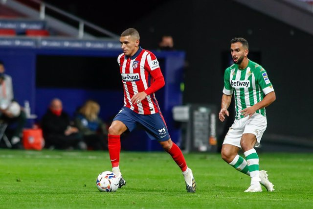 Lucas Torreira of Atletico de Madrid and Martin Montoya of Real Betis in action during the spanish league, La Liga, football match played between Atletico de Wanda Metropolitano stadium on October 24, 2020 in Madrid, Spain.