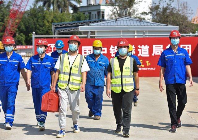 Un grupo de obreros de la construcción.