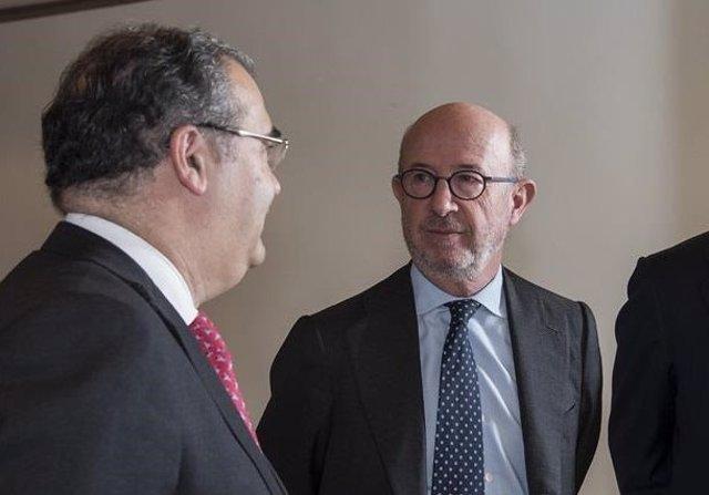 Los expresidentes de Banco Popular, Ángel Ron y Emilio Saracho.