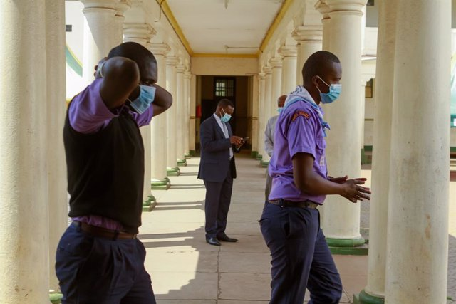 12 October 2020, Kenya, Nairobi: Students maintain social distance at Jamhuri Secondary school on the first day in school after the Kenyan government reopened schools having been closed since March due to the coronavirus (Covid-19) pandemic. Photo: Bonifa