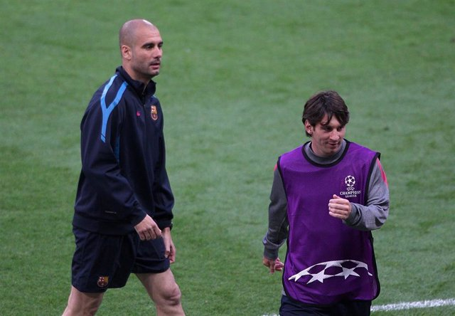 Pep Guardiola (L), then Barcelona head coach and his Barcelona's Lionel Messi take part in a training session. Messi has communicated to Barcelona via fax that he wants to leave the club on a free transfer this summer, according to media reports in Spain.