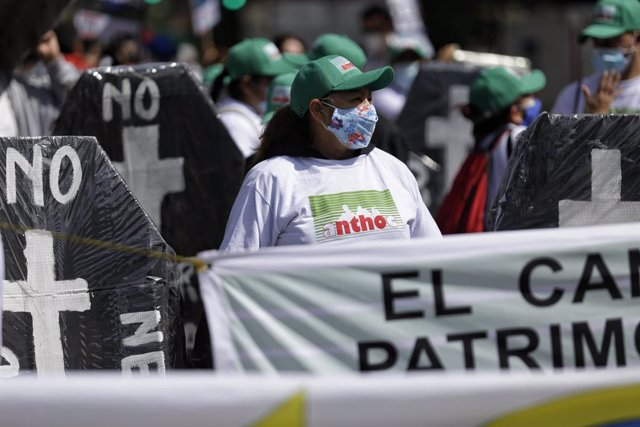 19 November 2020, Colombia, Bogota: People take part in a demonstration as part of the ongoing general strike which has been called by different unions to demand financial aid measures. Photo: Sergio Acero/colprensa/dpa