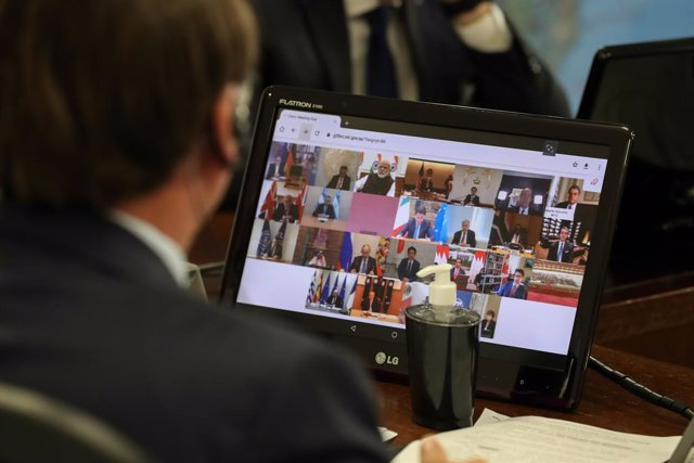 26 March 2020, Brazil, Brasilia: Jair Bolsonaro, President of Brazil speaks with other leaders of the G20 Group during a video conference to discuss the coronavirus (COVID-19) crisis. Photo: Marcos Correa/Agencia Brazil/dpa