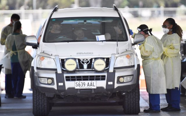 """Health workers test the public at a drive through COVID testing site at Victoria Park in Adelaide, Thursday, November 19, 2020. South Australia will go into lockdown for six days, with a range of restrictions to provide a """"circuit-breaker"""" and help contro"""