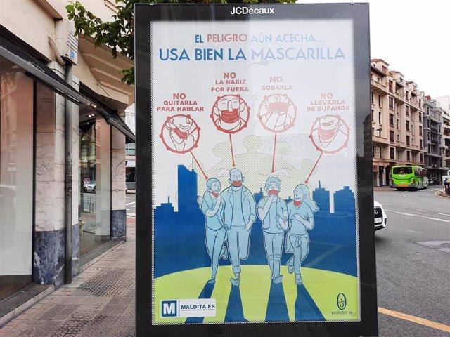 Cartel en Bilbao aconsejando el uso de la mascarilla