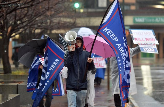 11 November 2020, US, Wilkes-Barre: A protester chants slogans on a megaphone during a 'Stop the Steal' protest demanding a recount of votes in Pennsylvania. Photo: Aimee Dilger/SOPA Images via ZUMA Wire/dpa
