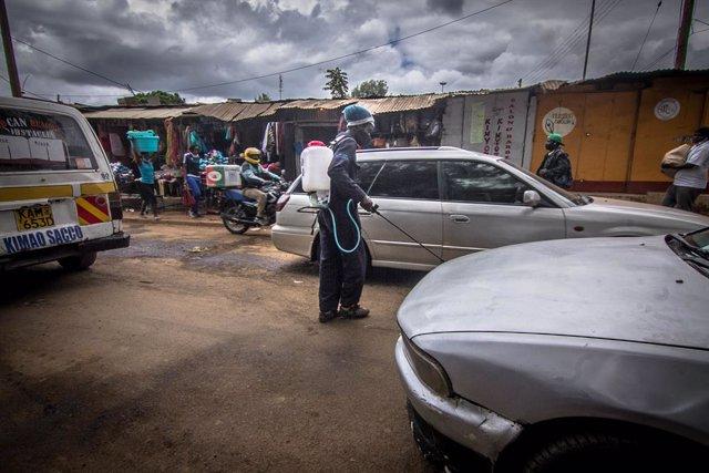 09 May 2020, Kenya, Nairobi: A man sprays disinfectants on vehicles as a preventative measure to curb the spread of the coronavirus. Photo: Donwilson Odhiambo/ZUMA Wire/dpa