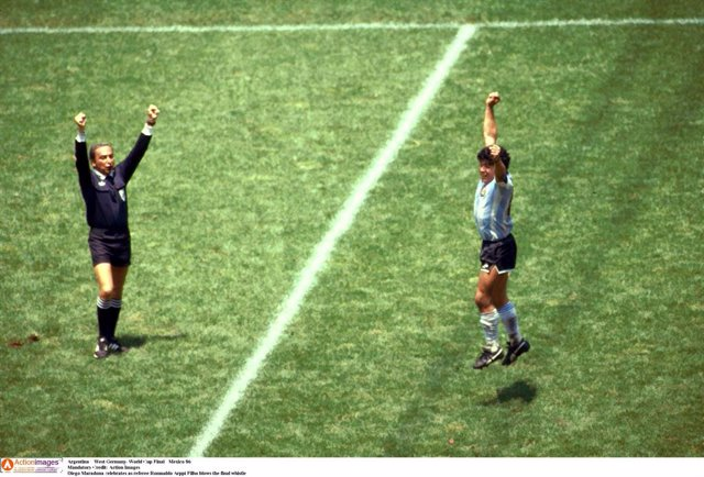 Diego Maradona of Argentina celebrates as referee Romualdo Arppi Filho blows the final whistle