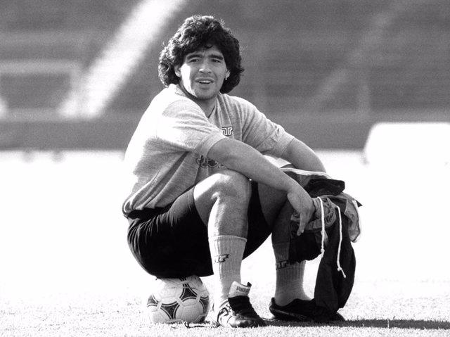 FILED - 16 May 1989, Stuttgart: Argentinian midfielder Diego Armando Maradona of S.S.C. Napoli sits on a ball during training. Argentina football great Diego Maradona has died at the age of 60, the Argentinian Football Association said on Wednesday. Photo