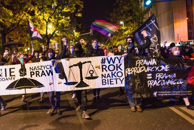 22 October 2020, Poland, Warsaw: Protesters hold a banner during an anti abortion demonstration. Photo: Attila Husejnow/SOPA Images via ZUMA Wire/dpa