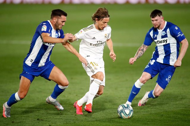 Luka Modric of Real Madrid and Lucas Perez of Alaves  in action during the Liga match between Real Madrid and Deportivo Alaves at Alfredo Di Stefano Stadium on July 10, 2020 in Valdebebas, Madrid, Spain.