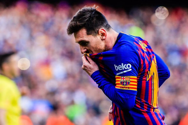 "10 Leo Messi of FC Barcelona celebrating his goal kissing his FC Barcelona shield at his t-shirt during the ""Derby"" of La Liga match between FC Barcelona and RCD Espanyol in Camp Nou Stadium in Barcelona 30 of March of 2019, Spain."