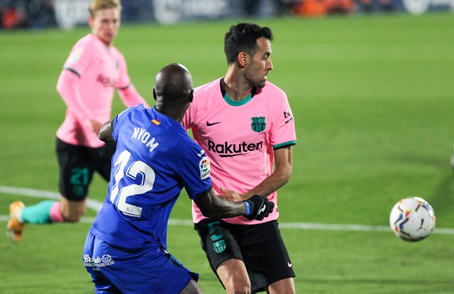 Allan Nyom of Getafe CF and Sergio Busquets of FC Barcelona fight for the ball during the spanish league,  La Liga, football match played between Getafe CF and FC Barcelona at Coliseum Alfonso Perez on October 17, 2020 in Getafe, Madrid, Spain.