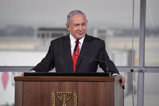 HANDOUT - 26 November 2020, Israel, Tel Aviv: Israeli Prime Minister Benjamin Netanyahu speaks during the reception ceremony for the United Arab Emirates airline flydubai's first commercial flight to Israel, at Ben Gurion International Airport. Photo: Kob