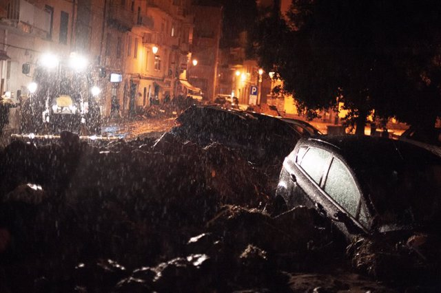 28 November 2020, Italy, Nuoro: Vehicles are seen partially submerged in mud in Nuoro's city centre after the area was flooded with a massive mudslide caused by a Heavy storm on the Italian Mediterranean island of Sardinia. Photo: Alessandro Tocco/LaPress