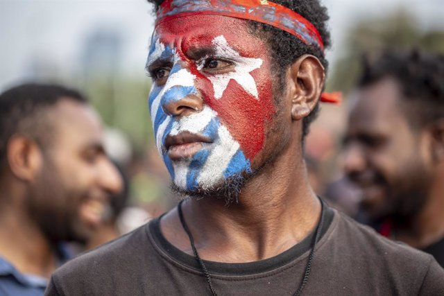 22 August 2019, Indonesia, Jakarta: Students from Papua Province take part in a protest in front of Merdeka Palace to call for a referendum on independence in their homeland. Photo: Donal Husni/ZUMA Wire/dpa